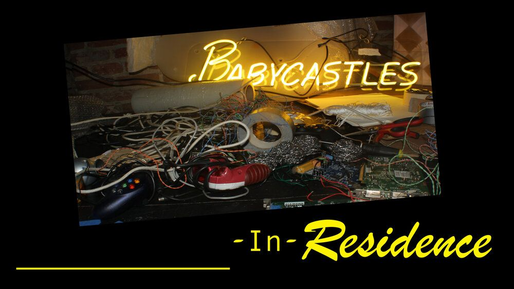 a pile of cords and stuff with the Babycastles neon light logo